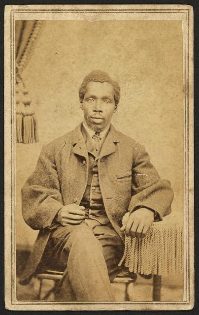 [Full-length portrait of unidentified African American man seated]