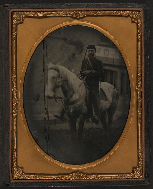 [Outdoor scene, mounted cavalry soldier seated on horse]