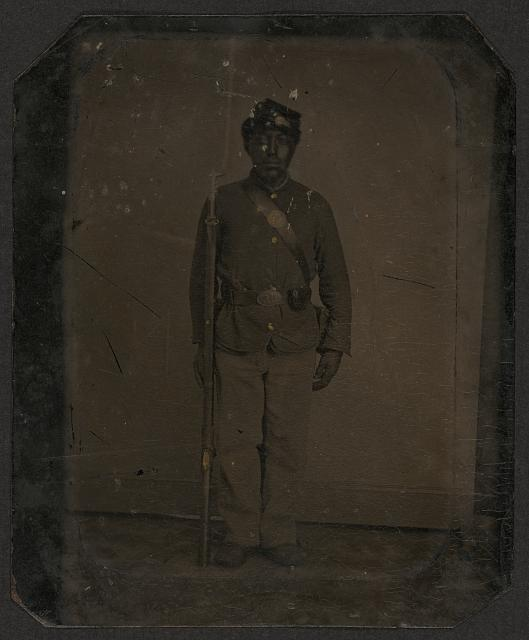 [Full standing black soldier, rifle with fixed bayonet]