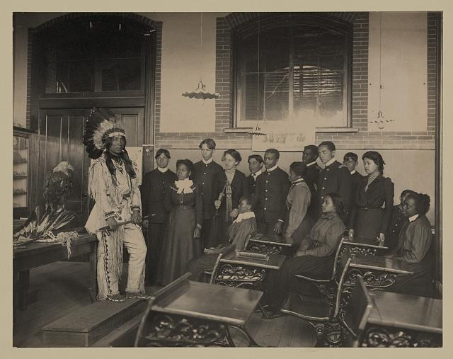 [Louis Firetail (Sioux, Crow Creek), wearing tribal clothing, in American history class, Hampton Institute, Hampton, Virginia]