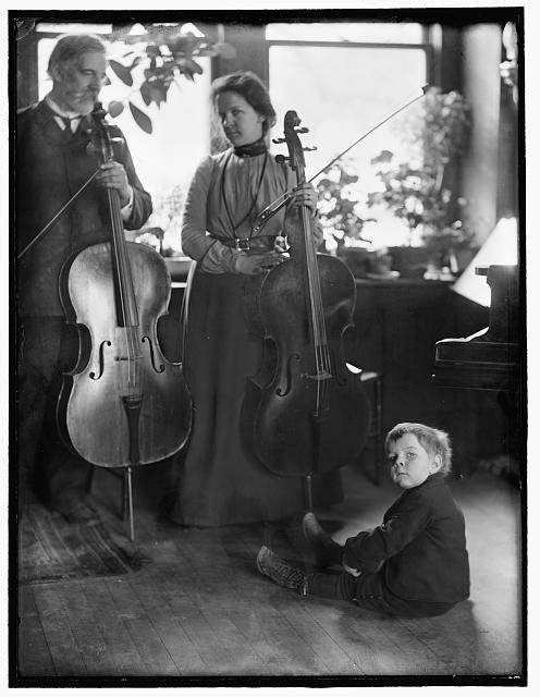 [Harmony, a study of the Brundigee family (father, mother and child) and their musical instruments, made in the photographer's New York City studio]