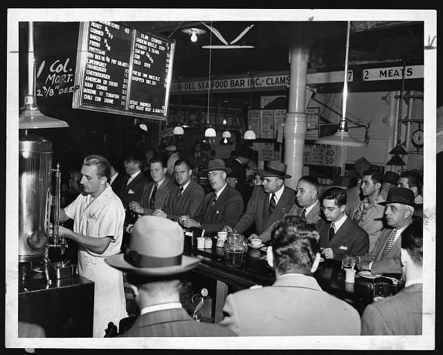 [People eating at Pete's Bar in Washington Market]