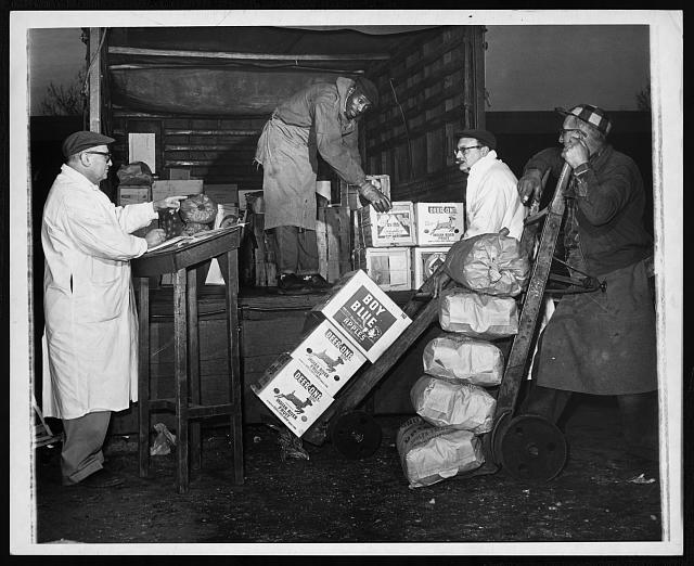 [Jack Fried, co-owner of Carnesie Fruit & Produce, supervises the loading of produce for delivery]