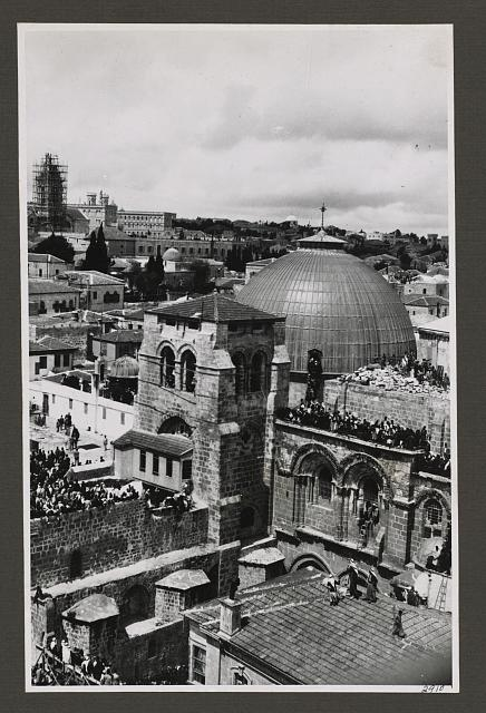 "Church of Holy Sepulchre and surroundings. Sepulchre Church. Easter crowds on roof awaiting ""Holy Fire"""