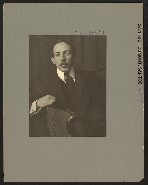 [Alberto Santos-Dumont, half-length portrait, facing front, sitting, with right arm resting on back of chair]