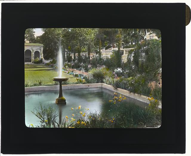 [Mrs. Eldridge Merick Fowler house, 363 Grove Street, Pasadena, California. Fountain in flower garden]