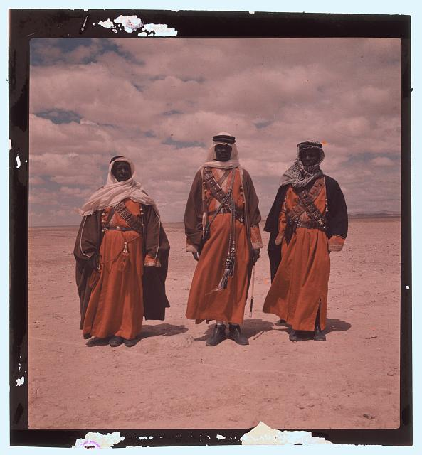 [Three Bedouin men, standing, facing front]