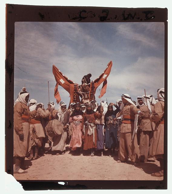 [Romani men and women staging a Bedouin wedding, Syria]
