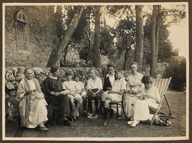 [Members of the American Colony in Jerusalem, seated outside]