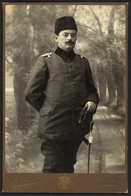[Doctor and author Tawfīq Kanʻān, three-quarter length portrait, standing, facing front, in uniform]