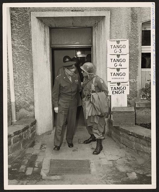 General Dwight D. Eisenhower, Supreme Allied Commander, talks with Major Gen. Matthew B. Ridgway, CG, 18th Corps, at a headquarters in Germany, during General Eisenhower's tour of the western front
