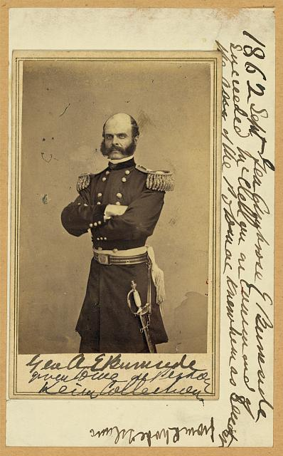 [Brig. Gen. Ambrose E. Burnside, three-quarter length portrait, standing, facing slightly left, arms folded across chest, wearing military uniform]
