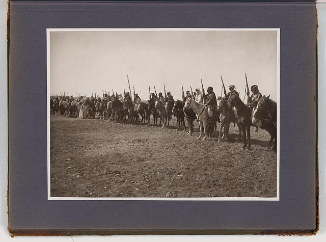 [Line of Bedouin men with rifles on horseback]
