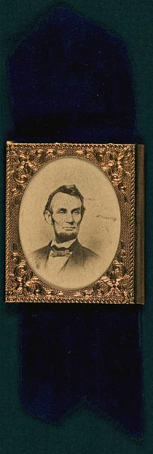 [Abraham Lincoln mourning badge, with photo taken Feb. 9 1864]