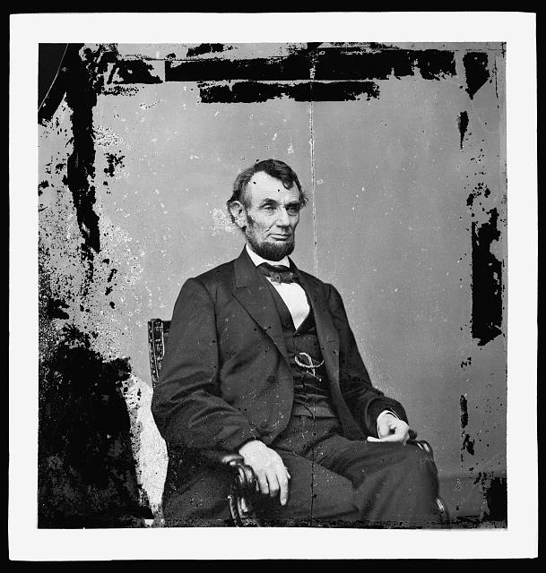 [Abraham Lincoln, President of the United States, three-quarter length portrait, seated, facing right]
