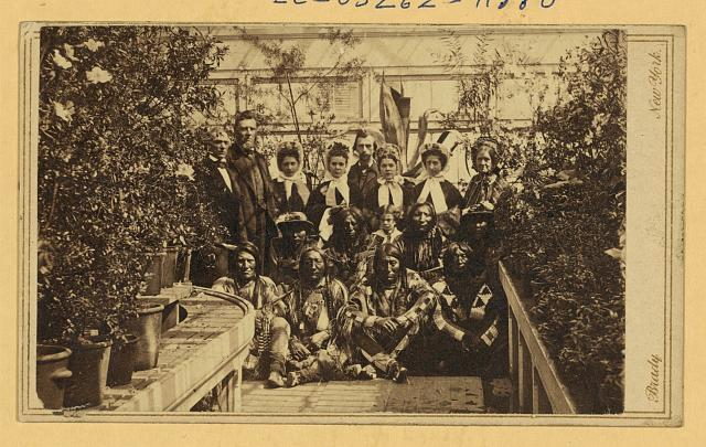 [Indian delegation in the White House Conservatory during the Civil War, with J.G. Nicolay, President Abraham Lincoln's secretary, standing in center back row ]