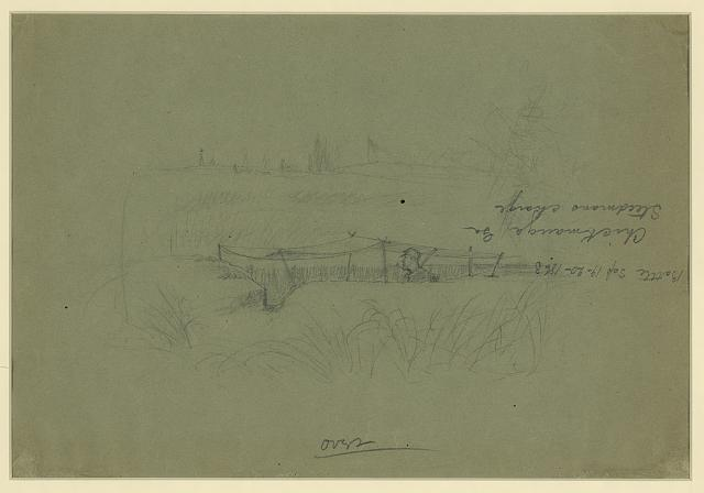 [Soldier standing in a rifle pit covered by a canopy]