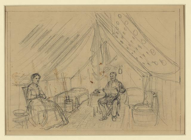[An officer and a woman sitting in a tent]