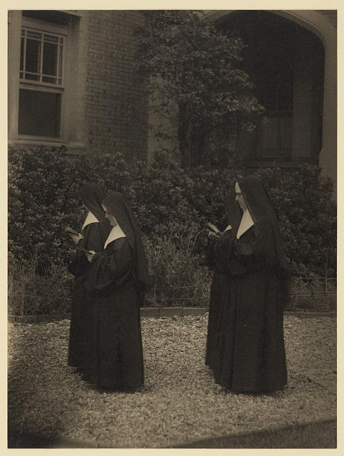 [Four nuns in procession]