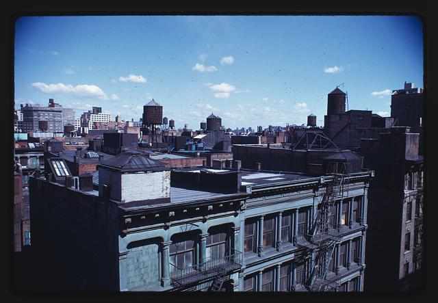 [Lower Manhattan Expressway, New York City. Rooftops and water towers typical of project area]