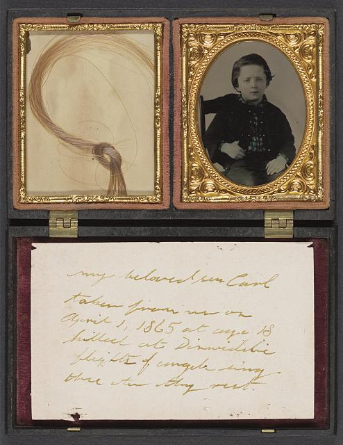 [Child named Carl who became a soldier; with handwritten note and lock of hair in case]