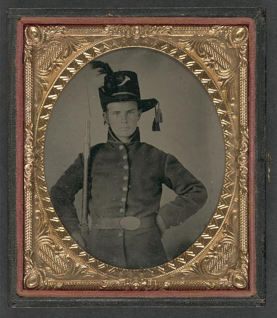 [Unidentified young soldier in Union uniform and Hardee hat with bayoneted musket]