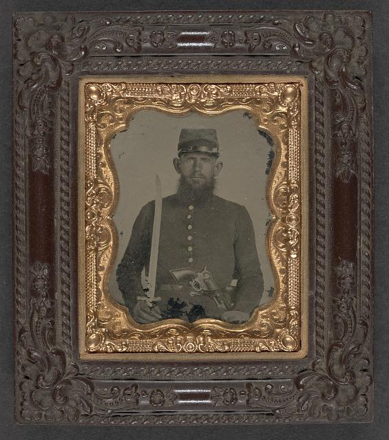[Unidentified soldier in Union uniform with revolver and sword]