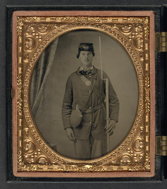 [Unidentified soldier in Union uniform with canteen and bayoneted musket]