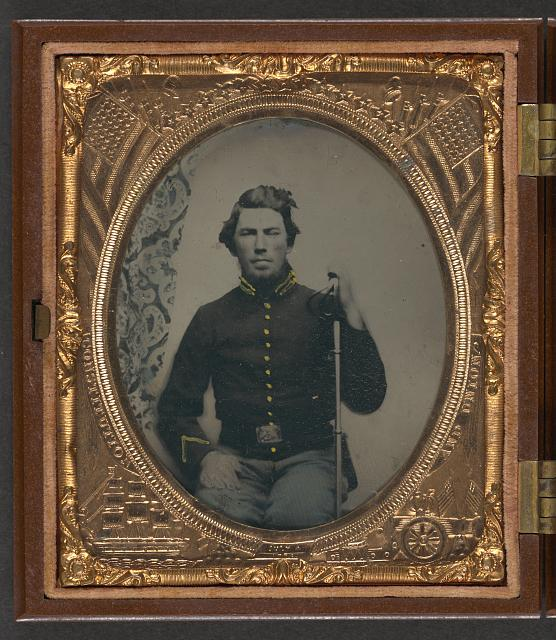 [Unidentified soldier in Union cavalry uniform sitting with saber]