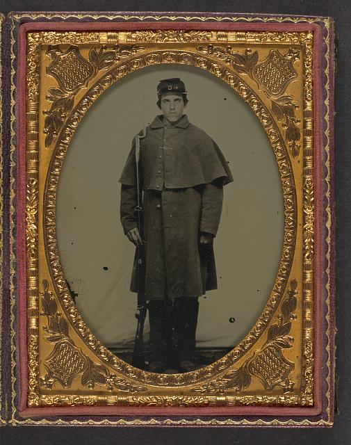 [Unidentified soldier in Union greatcoat with forage hat standing with bayoneted musket]