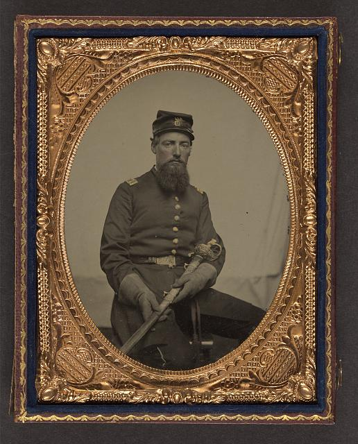 [Unidentified soldier in Union first lieutenant's uniform with U.S. Model 1850 staff and field officer's sword]