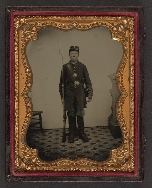 [Unidentified young soldier in Union uniform with bayoneted musket and cartridge box]