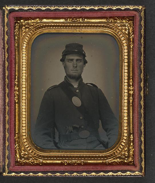 [Unidentified soldier in Union uniform with U.S. breast plate with revolver and bayonet in scabbard]