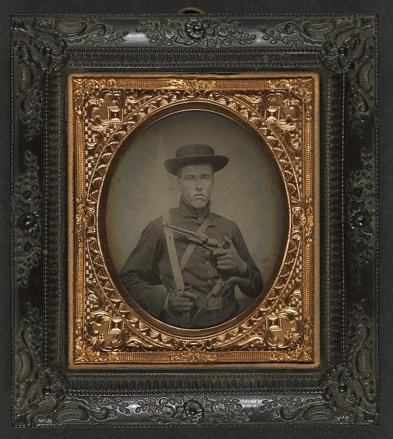 [Unidentified soldier in Union uniform with saber and dual revolvers]