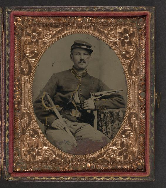 [Unidentified soldier in Union cavalry uniform with Colt Army Model 1860 revolver and cavalry saber]