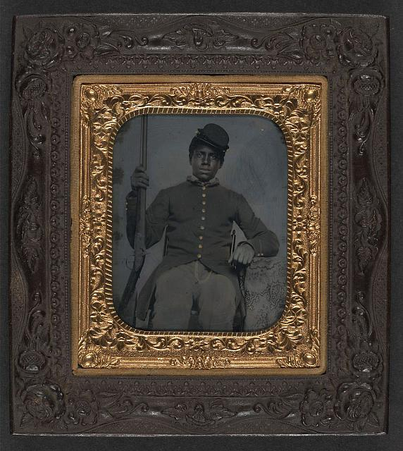 [Unidentified African American soldier in Union sergeant uniform holding a rifle]