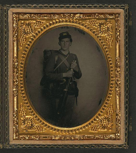 [Unidentified soldier in Union uniform with musket, bayonet and scabbard, and knapsack]