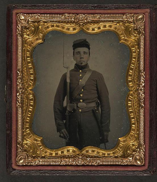 [Unidentified soldier in Union uniform and eagle breast plate with bayoneted musket, cap box, and bayonet scabbard]