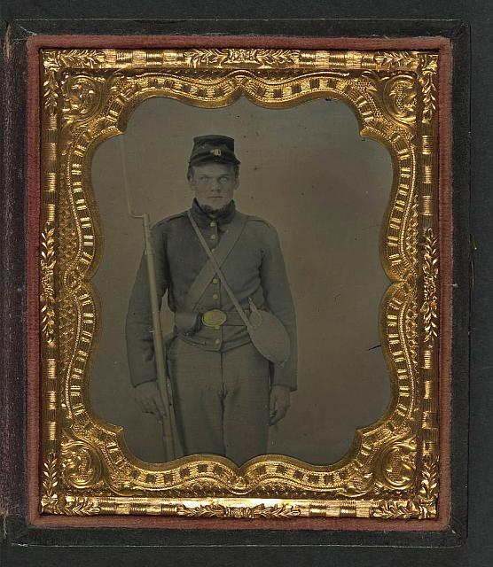 [Unidentified soldier in Union uniform with bayoneted musket, cap box, and canteen]