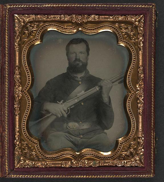 [Unidentified soldier in Union uniform with musket and cap box]