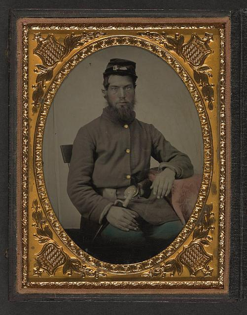 [Unidentified soldier in Union uniform with bayonet, scabbard, and cap box]