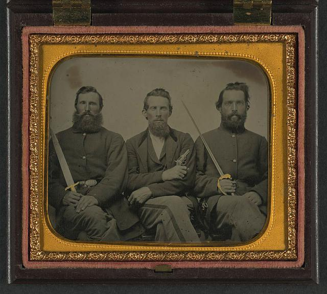 [Three unidentified soldiers in Union uniform with swords and revolver]