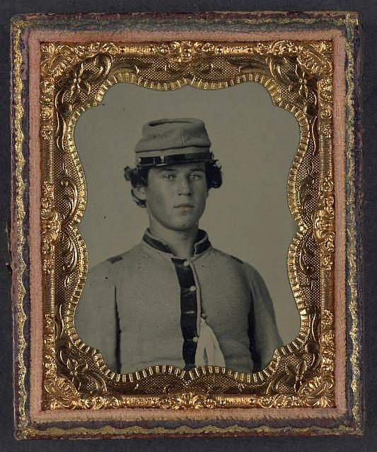 [Unidentified soldier in Confederate uniform and forage cap]