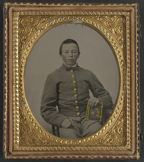 [Unidentified young soldier in Confederate uniform holding book]