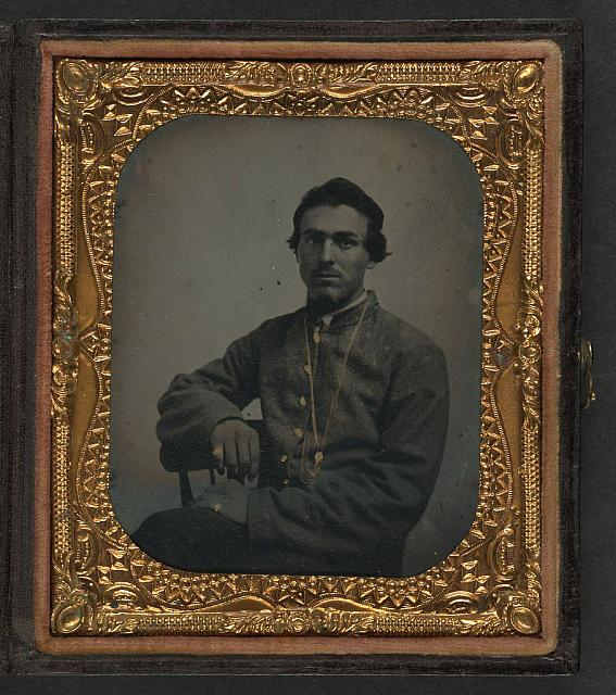 [Unidentified soldier in Confederate uniform wearing chain]