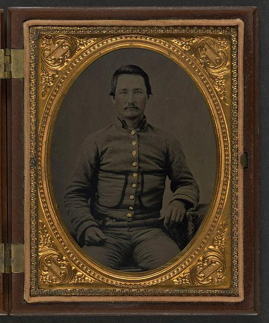 [Unidentified soldier in Confederate shell jacket with fringed pockets]