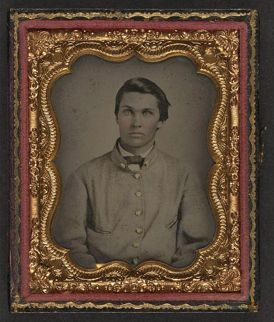 [Unidentified young soldier in Confederate sack coat]