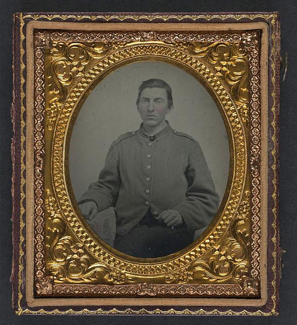 "[Unidentified soldier in Confederate shell jacket with ""I"" buttons]"