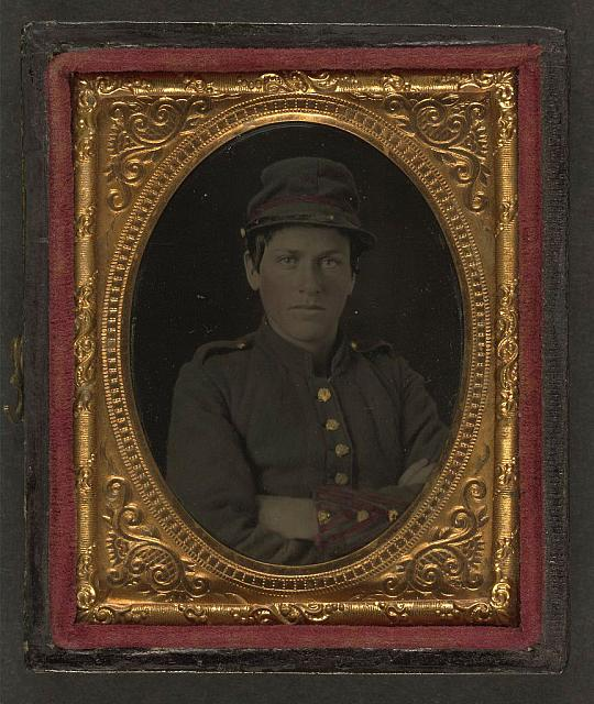 [Unidentified young soldier in Confederate artillery uniform and forage cap]