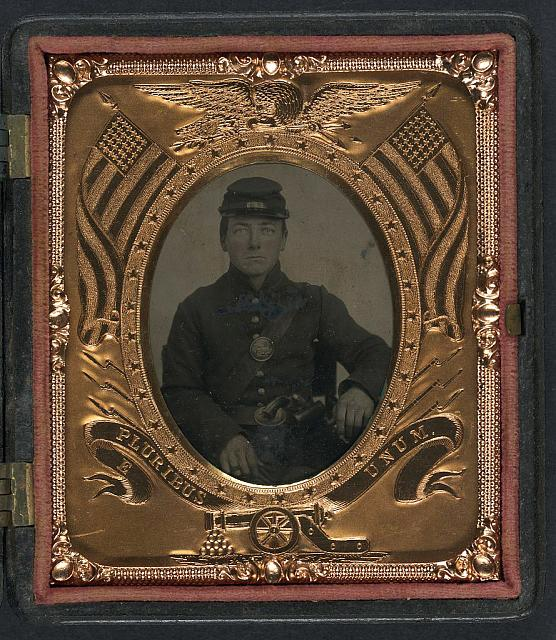 [Roswell K. Bishop of Company I, 123rd New York Infantry Regiment in uniform with holstered revolver]